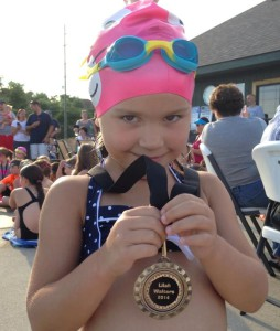 Lilah swim team award